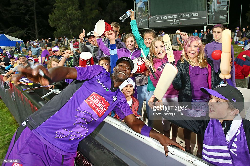 Darren Sammy of the Hurricanes poses after signing autographs for young supporters in the crowd after the Big Bash League match between Hobart Hurricanes and Brisbane Heat at Blundstone Arena on December 22, 2015 in Hobart, Australia.