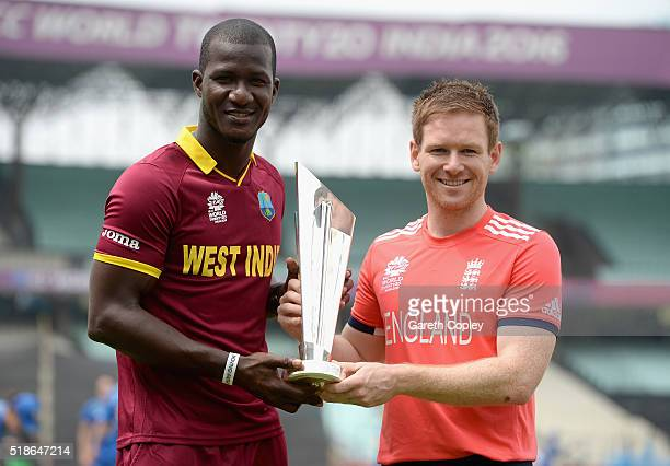 Darren Sammy of the West Indies and England captain Eoin Morgan pose with the ICC World T20 trophy ahead of tomorrrow's ICC World Twenty20 India 2016...