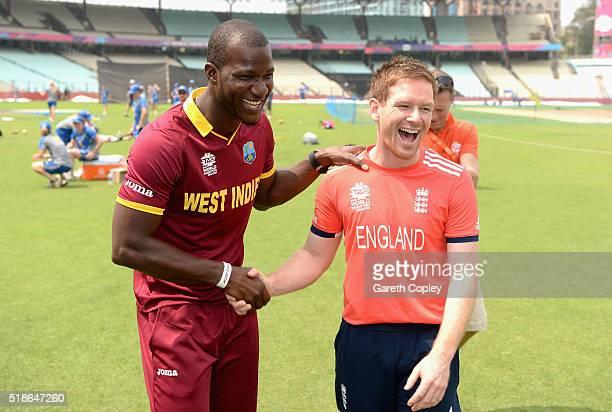 Darren Sammy of the West Indies and England captain Eoin Morgan share a joke ahead of tomorrrow's ICC World Twenty20 India 2016 Final between England...