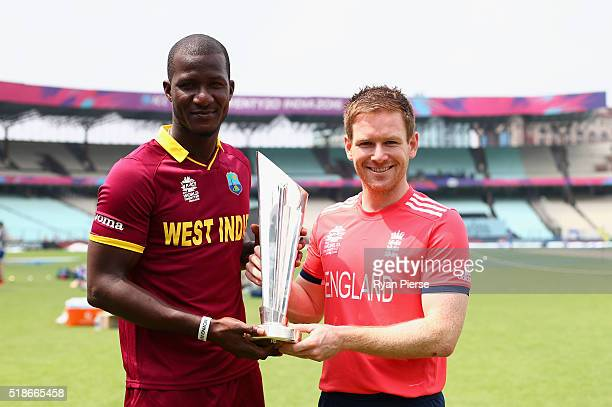 Darren Sammy of the West Indies and Eoin Morgan of England hold the trophy during previews ahead of the ICC World Twenty20 India Final between...