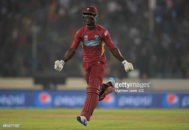 Darren Sammy of the West Indies celebrates hitting the winning runs to defeat Australia during the ICC World Twenty20 Bangladesh 2014 match between...
