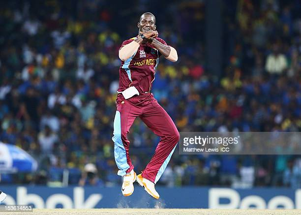 Darren Sammy of the West Indies celebrates the wicket of Lahiru Thirimanne of Sri Lanka after he was caught by Johnson Charles during the ICC World...