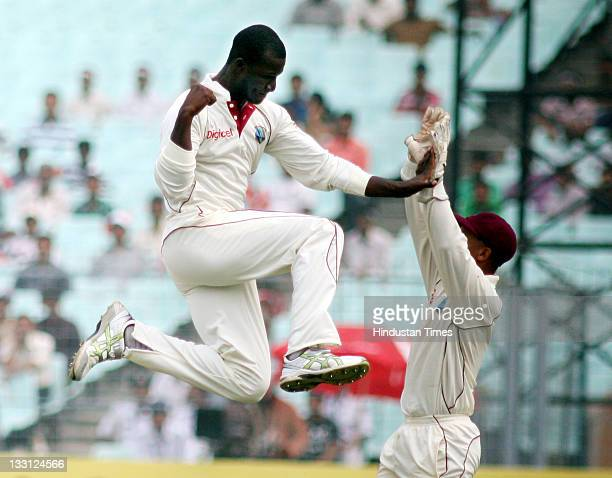 Darren Sammy of West Indies celebrates after taking the wicket of Indian batsman Yuvraj Singh during the second day of second Test Match between...