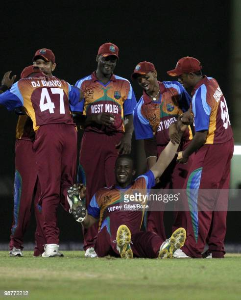 Darren Sammy of West Indies is congratulated on his match winning performance after taking the final wicket during the ICC T20 World Cup Group D...