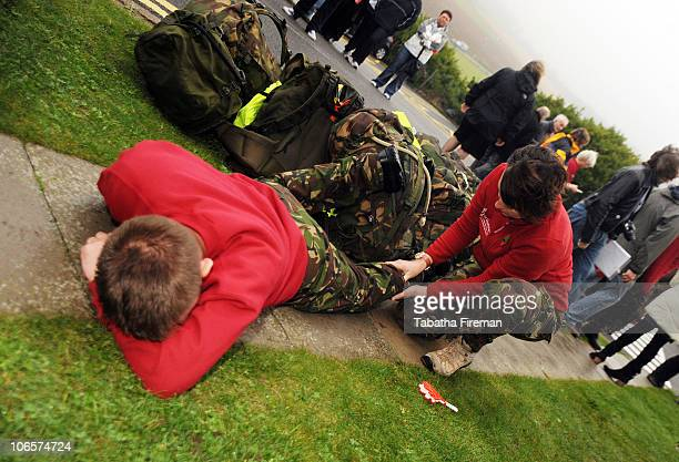 Darren Sapper and physiotherapist Arlene Holmes attend to weary muscles after the team of Royal Engineers from 39 Engineer Regiment Cambridge arrive...