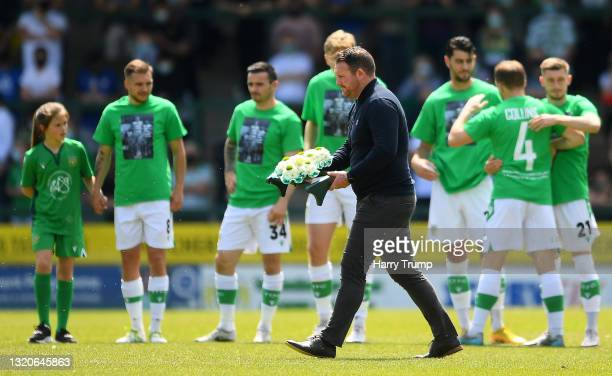 Darren Sarll, Manager of Yeovil Town lays a wreath in the middle of the pitch as a mark of respect to Yeovil Town Footballer Lee Collins who recently...