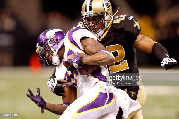 Darren Sharper of the New Orleans Saints attempts to tackle Bernard Berrian of the Minnesota Vikings during the NFC Championship Game at the...