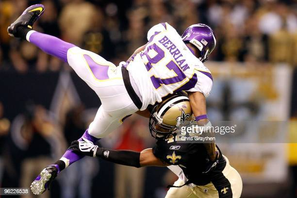 Darren Sharper of the New Orleans Saints hits Bernard Berrian of the Minnesota Vikings during the NFC Championship Game at the Louisiana Superdome on...