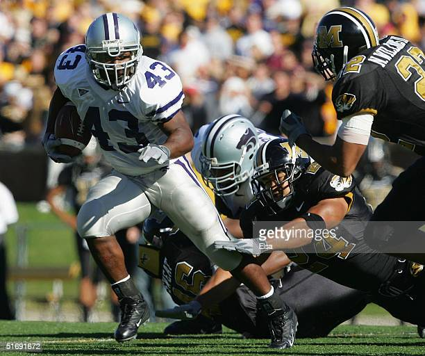Darren Sproles of the Kansas State Wildcates breaks away from James Kinney of the Missouri Tigers to score a touchdown in the second quarter on...
