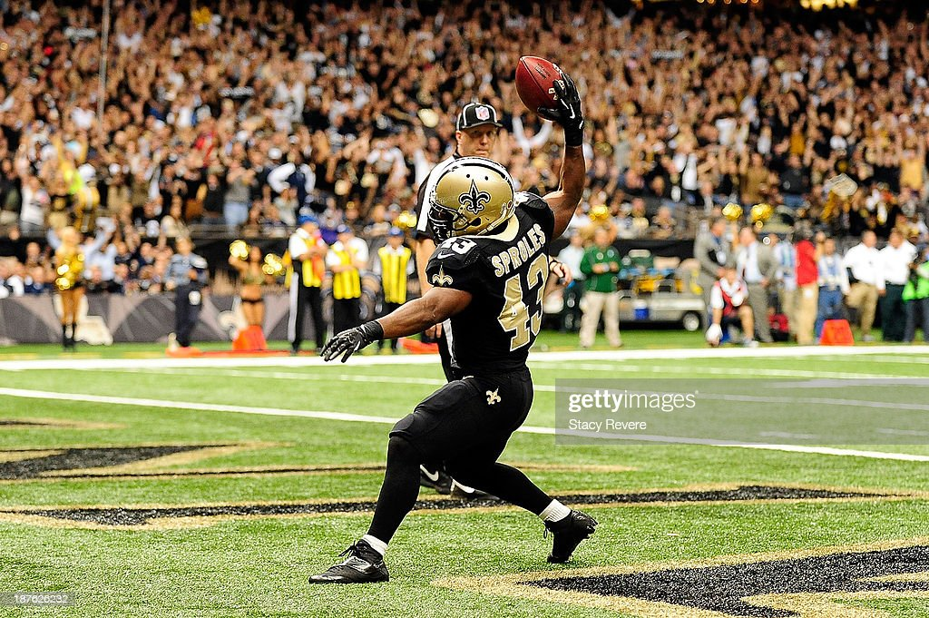 Darren Sproles #43 of the New Orleans Saints celebrates a touchdown during a game against the Dallas Cowboys at the Mercedes-Benz Superdome on November 10, 2013 in New Orleans, Louisiana. New Orleans won the game 49-17.