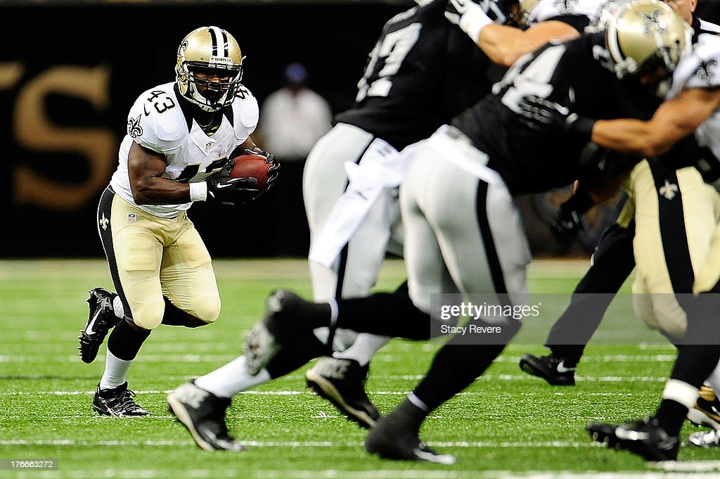 Darren Sproles #43 of the New Orleans Saints looks for an opening against the Oakland Raiders during a preseason game at the Mercedes-Benz Superdome on August 16, 2013 in New Orleans, Louisiana.
