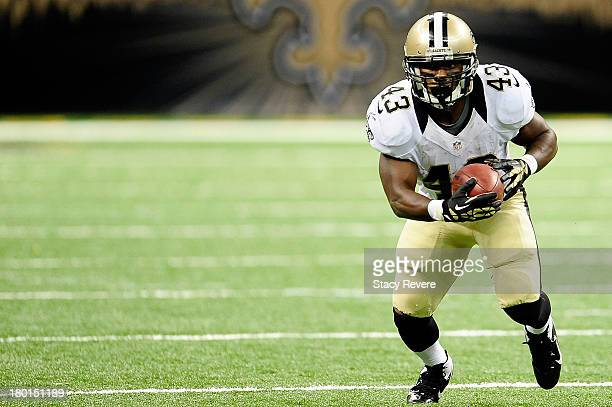 Darren Sproles of the New Orleans Saints runs for yards against the Atlanta Falcons during a game at the MercedesBenz Superdome on September 8 2013...