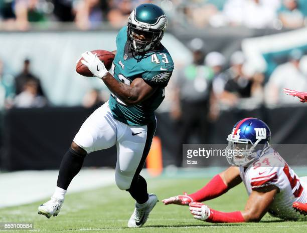 Darren Sproles of the Philadelphia Eagles carries the ball as Olivier Vernon of the New York Giants defends on September 24 2017 at Lincoln Financial...