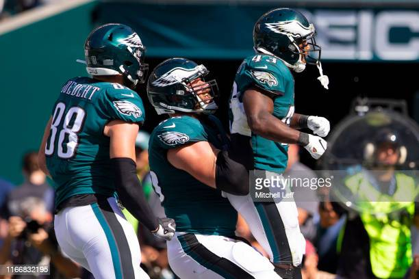 Darren Sproles of the Philadelphia Eagles celebrates with Dallas Goedert and Lane Johnson after converting a two point conversion in the fourth...