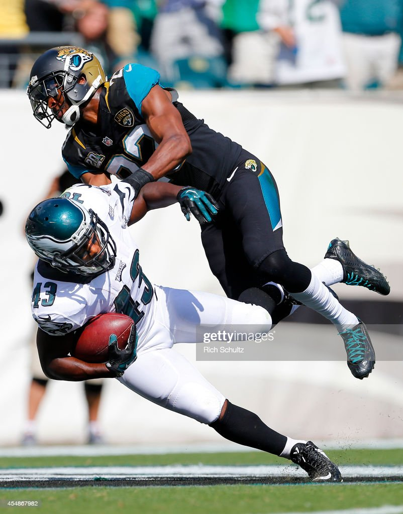 Darren Sproles #43 of the Philadelphia Eagles is tackled in the end zone by Alan Ball #23 of the Jacksonville Jaguars after a 49 yard run for a touchdown during the third quarter of a NFL game at Lincoln Financial Field on September 7, 2014 in Philadelphia, Pennsylvania. The Eagles defeated the Jaguars 34-17.