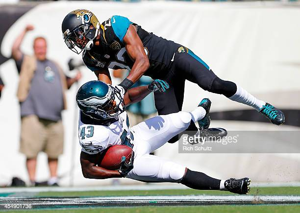 Darren Sproles of the Philadelphia Eagles is tackled in the end zone by Alan Ball of the Jacksonville Jaguars on a 49yard touchdown during the third...