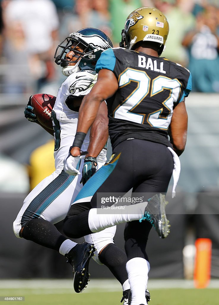 Darren Sproles #43 of the Philadelphia Eagles outruns Alan Ball #23 of the Jacksonville Jaguars on a 49-yard touchdown during the third quarter of a NFL game at Lincoln Financial Field on September 7, 2014 in Philadelphia, Pennsylvania. The Eagles defeated the Jaguars 34-17.