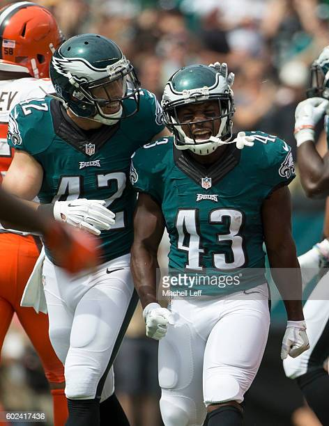 Darren Sproles of the Philadelphia Eagles reacts after a punt return with Chris Maragos in the first quarter against the Cleveland Browns at Lincoln...