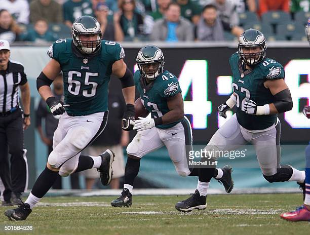 Darren Sproles of the Philadelphia Eagles runs behind the blocking of Lane Johnson and Jason Kelce against the Buffalo Bills on December 13 2015 at...