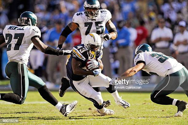 Darren Sproles of the San Diego Chargers is surrounded by Philadelphia Eagles defenders during the NFL football game at Qualcomm Stadium on November...