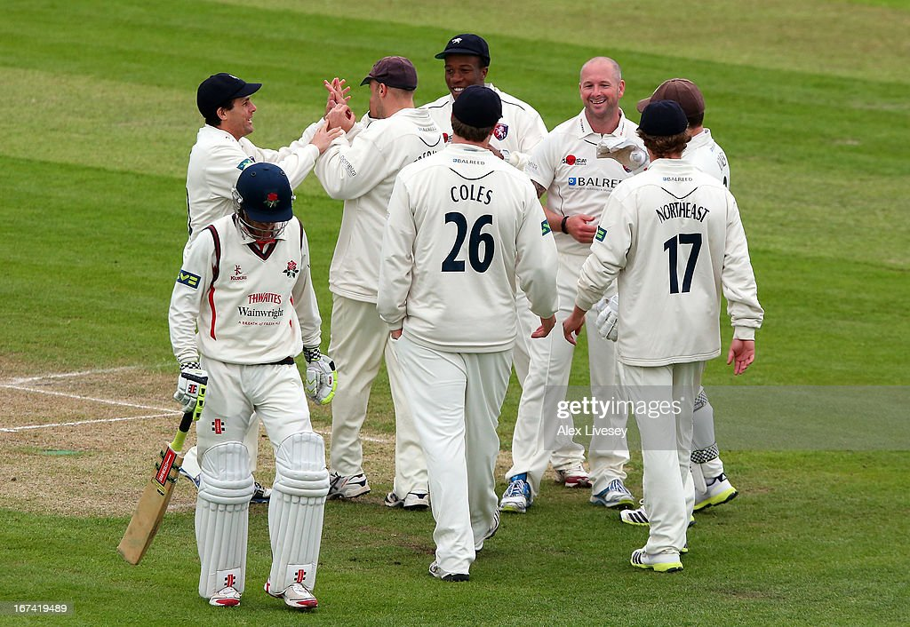 Darren Stevens of Kent celebrates with team mates after taking the wicket of Luke Procter of Lancashire during the LV County Championship Division Two match between Lancashire and Kent at Emirates Old Trafford on April 25, 2013 in Manchester, England.