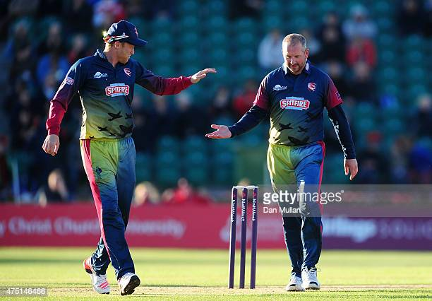 Darren Stevens of Kent Spitfires celebrates with Adam Riley of Kent Spitfires after taking the wicket of Kumar Sangakkara of Surrey during the...