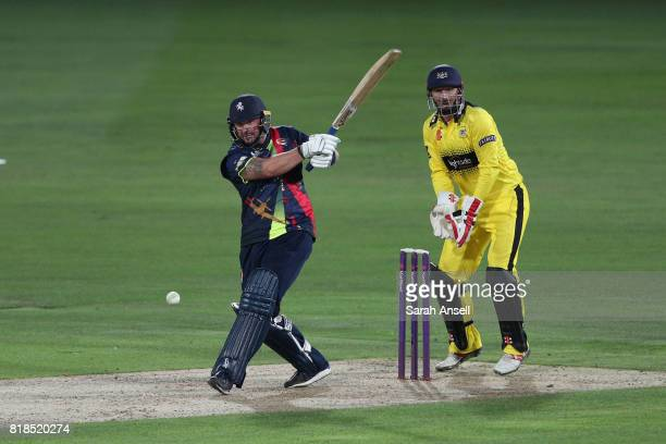 Darren Stevens of Kent Spitfires hits a boundary as Gloucestershire wicket keeper Phil Mustard looks on during the NatWest T20 Blast South Group...