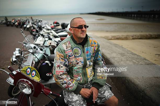 Darren Stevens sits on his scooter on the sea front during the the Isle of Wight International Scooter Rally on August 24 2013 in Ryde England The...