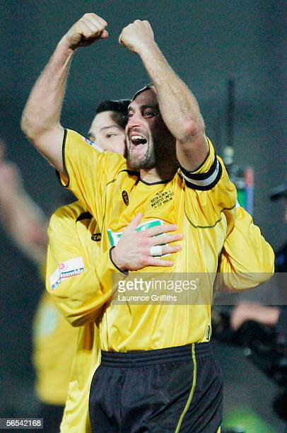 Darren Stride of Burton celebrates at the end of the FA Cup Third Round match between Burton Albion and Manchester United on January 8 2006 at...