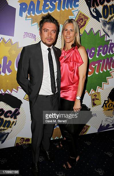 Darren Strowger and Clare Strowger attend The Hoping Foundation's 'Rock On' a benefit evening for Palestinian refugee children at Cafe de Paris on...