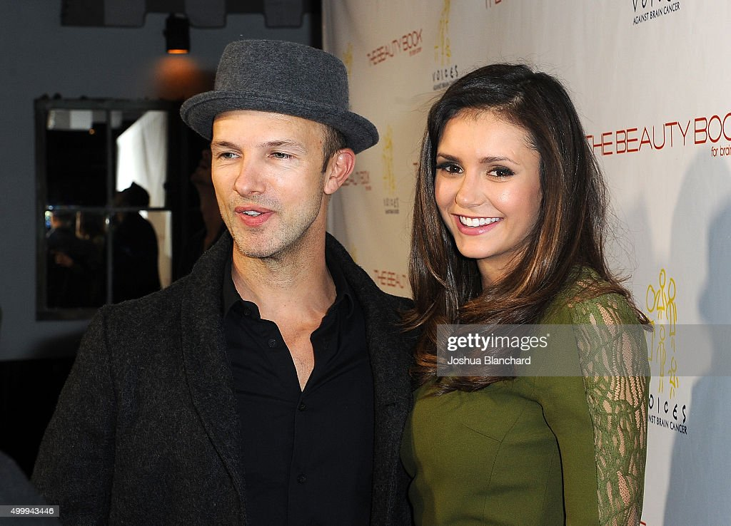 Darren Tieste (L) and Nina Dobrev arrive at 'The Beauty Book For Brain Cancer' Edition Two Launch Party sponsored by Voices Against Brain Cancer on December 3, 2015 in Los Angeles, California.