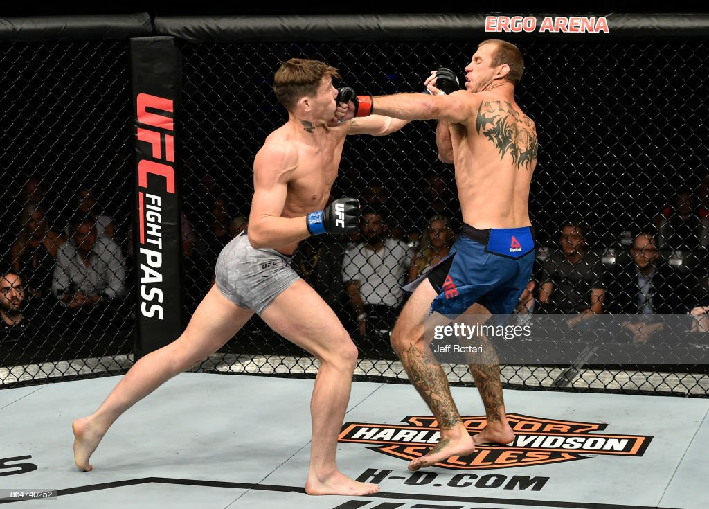 Darren Till of England and Donald Cerrone trade punches in their welterweight bout during the UFC Fight Night event inside Ergo Arena on October 21, 2017 in Gdansk, Poland.