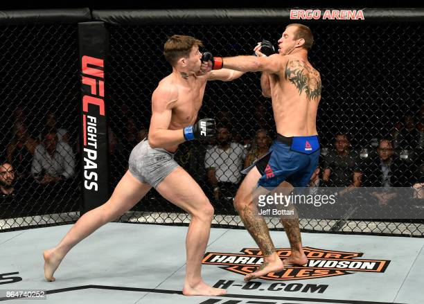 Darren Till of England and Donald Cerrone trade punches in their welterweight bout during the UFC Fight Night event inside Ergo Arena on October 21...