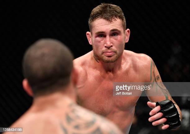 Darren Till of England battles Robert Whittaker of New Zealand in their middleweight fight during the UFC Fight Night event inside Flash Forum on UFC...