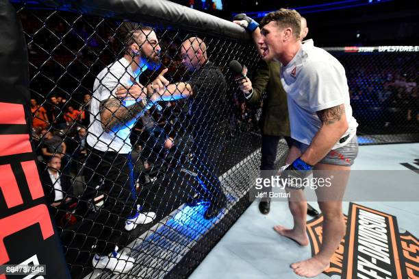 Darren Till of England has words with Mike Perry after his victory over Donald Cerrone during the UFC Fight Night event inside Ergo Arena on October...