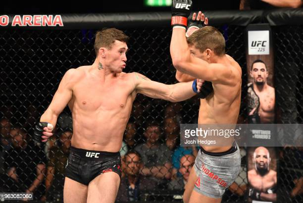 Darren Till of England hits Stephen Thompson with a spinning back fist in their welterweight bout during the UFC Fight Night event at ECHO Arena on...