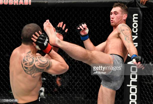 Darren Till of England kicks Robert Whittaker of New Zealand in their middleweight fight during the UFC Fight Night event inside Flash Forum on UFC...