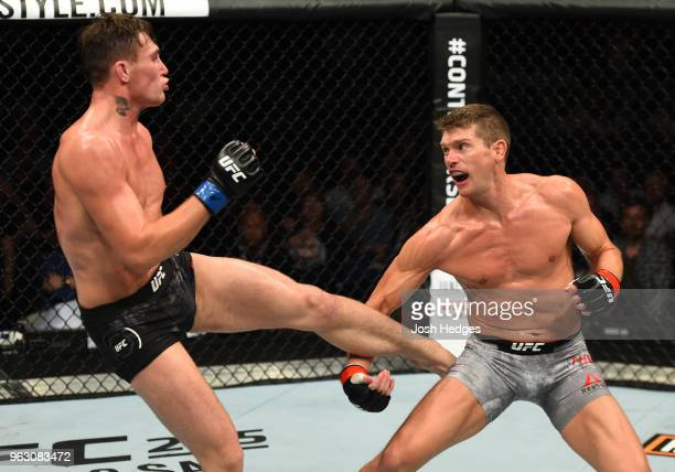 Darren Till of England kicks Stephen Thompson in their welterweight bout during the UFC Fight Night event at ECHO Arena on May 27 2018 in Liverpool...