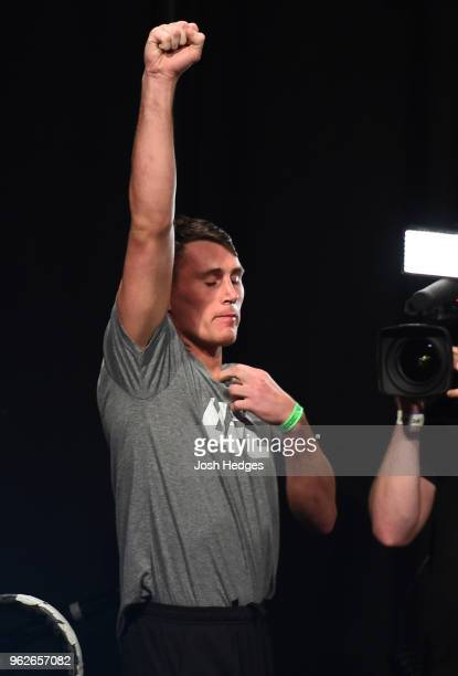 Darren Till of England prepares to step on the scale during the UFC Weighin at ECHO Arena on May 26 2018 in Liverpool England