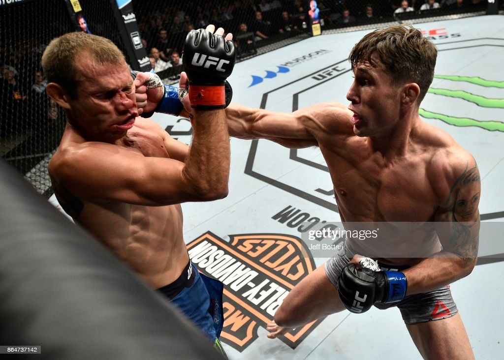 Darren Till of England punches Donald Cerrone in their welterweight bout during the UFC Fight Night event inside Ergo Arena on October 21, 2017 in Gdansk, Poland.
