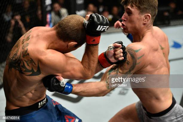 Darren Till of England punches Donald Cerrone in their welterweight bout during the UFC Fight Night event inside Ergo Arena on October 21 2017 in...