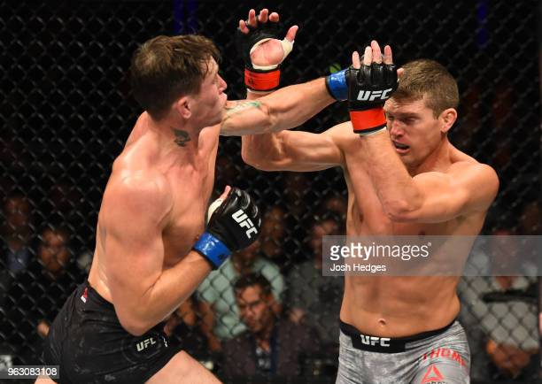 Darren Till of England punches Stephen Thompson in their welterweight bout during the UFC Fight Night event at ECHO Arena on May 27 2018 in Liverpool...