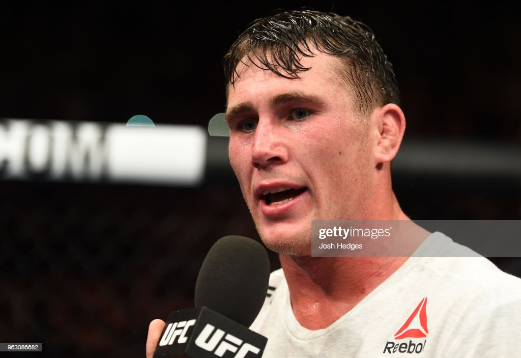 Darren Till of England talks with Dan Hardy after defeating Stephen Thompson in their welterweight bout during the UFC Fight Night event at ECHO Arena on May 27, 2018 in Liverpool, England.