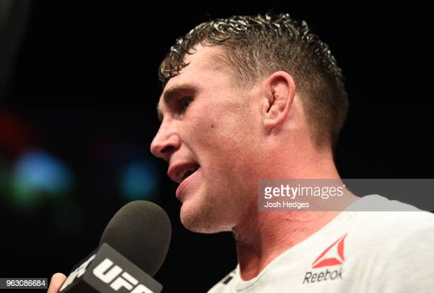 Darren Till of England talks with Dan Hardy after defeating Stephen Thompson in their welterweight bout during the UFC Fight Night event at ECHO...