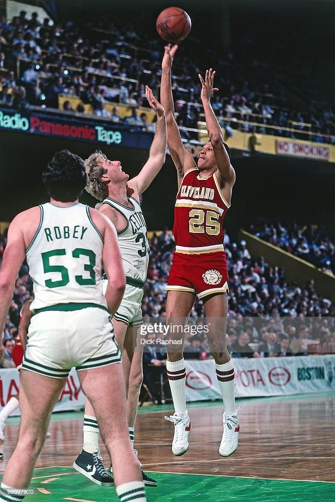 Darren Tillis #25 of the Cleveland Cavaliers shoots over Larry Bird #33 and Rick Robey #53 of the Boston Celtics during a game played in 1983 at the Boston Garden in Boston, Massachusetts.
