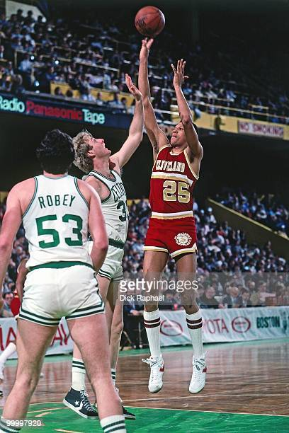 Darren Tillis of the Cleveland Cavaliers shoots over Larry Bird and Rick Robey of the Boston Celtics during a game played in 1983 at the Boston...