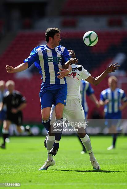 Darren Timmons of Whitley Bay battles with Matt Moore of Coalville Town during the FA Carlsberg Vase Final between Coalville Town and Whitley Bay at...
