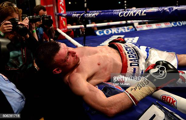 Darren Traynor of Scotland is knocked through the ropes by Ryan Walsh of England during their British Feathwerweight Championship Contest at York...