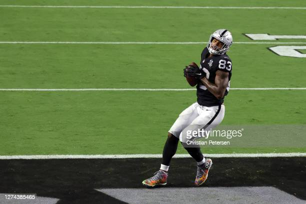Darren Waller of the Las Vegas Raiders catches a touchdown during the third quarter against the New Orleans Saints at Allegiant Stadium on September...