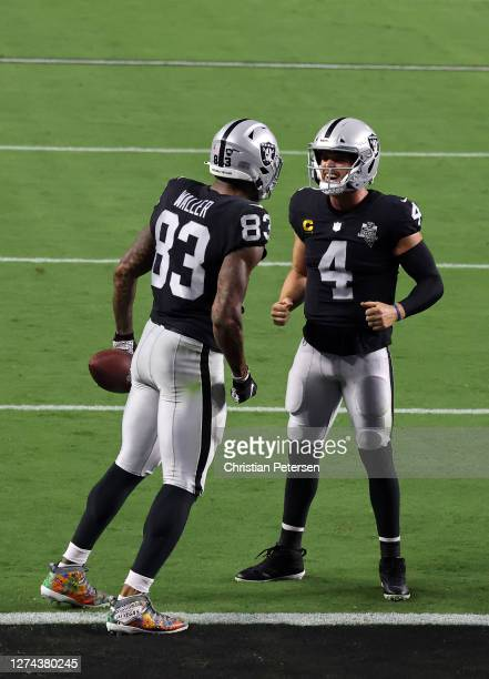 Darren Waller of the Las Vegas Raiders celebrates a touchdown with Derek Carr during the third quarter against the New Orleans Saints at Allegiant...